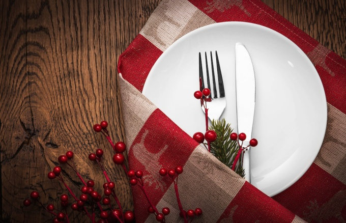 holiday menu concept with place setting and holly berries